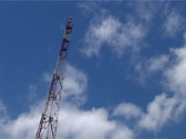 Cellular tower on the background of clouds Stock Footage