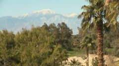 Palm Springs Resort with Snowy Mountains Zoom Out Stock Footage