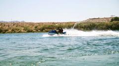 watercraft-couple on jet ski - stock footage