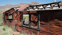 Desert-rusted mining shack 4495 Stock Footage