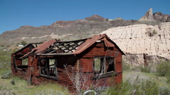 Desert-rusted mining shack 4497 Stock Footage