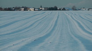 Snow field at a winter village Stock Footage