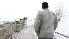 Couple walks in a winter mountain park Stock Footage