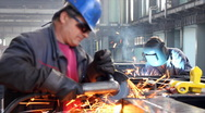 Stock Video Footage of Workers grinding and welding in a factory