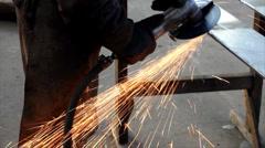 Worker grinds metal bar Stock Footage