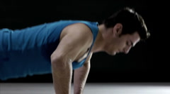 Young man doing push-ups in gym Stock Footage
