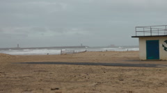 Winter beach with rough waves, lifeguard station Stock Footage