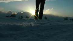 Man walking to the horizont in snow Stock Footage
