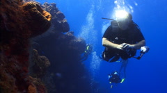 Scuba diver swimming on a wall - stock footage