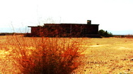 Stock Video Footage of Abandoned Building In The Desert Zoom