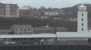 Stock Video Footage of North Shields Fish Market on quayside with modern urban apartments behind.