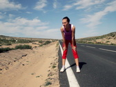 Tired woman resting after jogging on country road Stock Footage