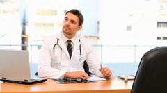Doctor having a visit - stock footage