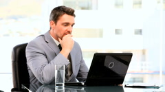 Young businessman despairing in front of his laptop Stock Footage
