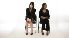 nervous young girls waiting for interview  - stock footage