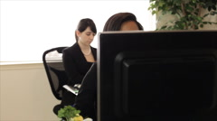 Helpdesk call center two girls working Stock Footage