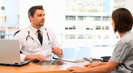 Doctor talking to his patient Stock Footage
