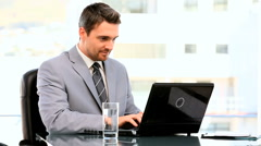 Stock Video Footage of Dark-haired businessman working on his laptop