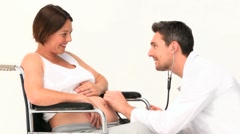 Doctor visiting a pregnant patient Stock Footage