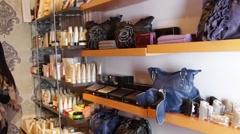 Females looking in shop at handbags Stock Footage