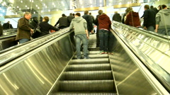 Going up the escalator inside the metro toronto convention center MTCC Stock Footage