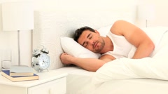 Young man sleeping on his bed - stock footage
