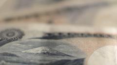 Rack focus across Japanese yen Stock Footage