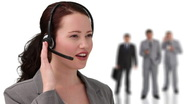 Brunette businesswoman speaking over the headset Stock Footage