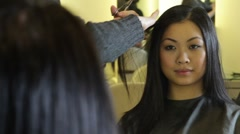 Hairstylist, cutting hair of female customer Stock Footage