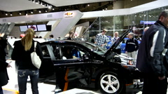 Shoppers checking out the GM Chevrolet Volt electric car at the car show Stock Footage