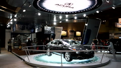 Brand new luxury Acura sedan on display at a car show - stock footage