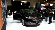 Black Lincoln SUV on display at the auto show Stock Footage