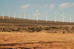 An electric wind farm / windmills in the desert Stock Footage