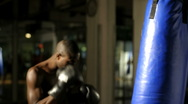 Stock Video Footage of Thai Boxer exercising;
