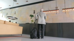 Dolly in hotel lobby Stock Footage
