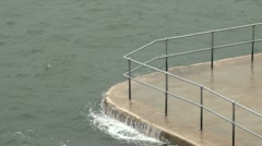 Waves Lapping Waterfront Railings  Stock Footage