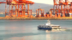 Ocean Ferry boat Travels past orange Port facility Machinery Stock Footage