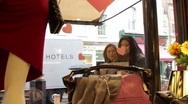 Females looking at window display of shop Stock Footage