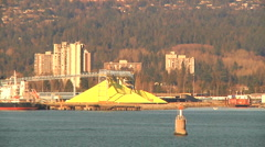 Yellow Sulphur pile at Industrial Port with ocean Freight Liner (zoom out) Stock Footage