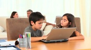 Stock Video Footage of Chlidren playing on a laptop