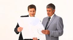 Businessmen holding a building plan Stock Footage