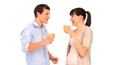 Attractive couple enjoying a glass of white wine Stock Footage