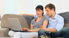 Attractive couple with a credit card - stock footage