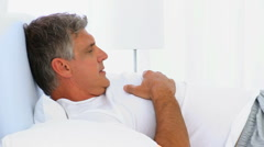 Middle aged man waking up Stock Footage