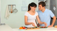 Woman teaching her boyfriend how to cook Stock Footage
