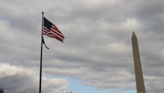 WWII Memorial US flag & Washington monument  DC Stock Footage