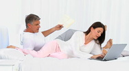 Modern couple using a laptop Stock Footage