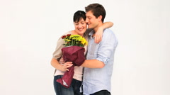 Loving couple with a bunch of flowers Stock Footage