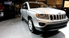 Rotating Jeep grand cherokee on display at the auto show - stock footage