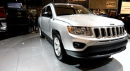 Rotating Jeep grand cherokee on display at the auto show Stock Footage